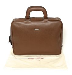 Store it right, in this SALVATORE FERRAGAMO Valigeria Pebble Calf Leather Briefcase Attache Bag!  |  Find yours! http://www.frieschskys.com/bags  |  #frieschskys #mensfashion #fashion #mensstyle #style #moda #menswear #dapper #stylish #MadeInItaly #Italy #couture #highfashion #designer #shopping