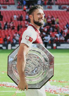 Arsenal's Olivier Giroud with the Shield during the FA Community Shield match between Arsenal and Chelsea at Wembley Stadium on August 6, 2017 in London, England.