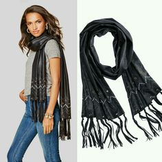 There's just something about a scarf that instantly transforms even the most basic of outfits. Add a little edge to your look with this fringe-tipped scarf from mark.