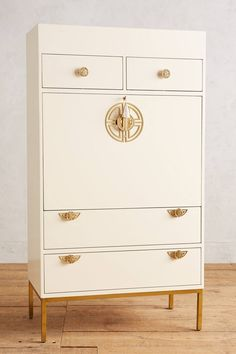Beautiful chinoiserie storage from Anthroplogie. Any way I can use this for nursery organization?