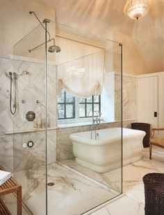 Luxury Bathroom With Freestanding Tub And Glass Shower Stall With Shower Head