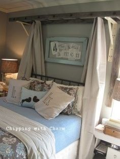 Fun way to hang curtains around a bed. Also love the Forever and Ever, Amen window. That was one of our songs! :)