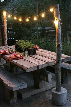 I love the idea of logs in cement to hold the lighting!