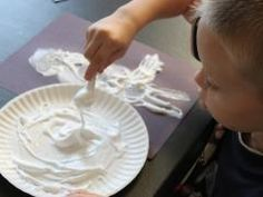 """Shaving Cream Snow Paint  Kids Crafts & Activities for Children  Kiwi Crate - To create this homemade """"snow"""" paint, mix one part shaving cream with one part glue. The mixture ends up thick and goopy--and dries up puffy, like snow!  More at http://www.kiwicrate.com/projects/Shaving-Cream-Snow-Paint-/799"""