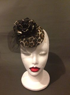 Can't get enough of leopard! This rockabilly pinup inspired design in leopard black, beige and brown, has an overlay of very fine net lace. Can look day time cute to race day fun! Fascinator hat hair clip style fashion by ParodyPetals, $49.99