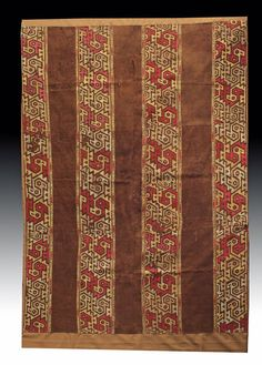 """""""Northern Coast, Peru, Chimu, ca. 1000 to 1300 CE. This Andean textile is composed of wool from alpaca or llama and cotton dyed with natural dyes that have retained their vibrant hues, mainly red, rose, and brown. Its fine condition is most likely attributed to the dry conditions of the Andes and protection from the region's sunlight. The composition consists of longitudinal panels of nested profiled birds delineated with their characteristic beaks and tails alternating with rich brown…"""
