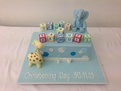 Cute christening cake for 2 boys by handi's cakes