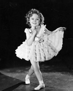 """Shirley Temple I hated her so much when I was a kid, my mom kept trying to explain """"Ali she's older than you, she is a grandma now"""" but that didn't matter, she was cute and had a beautiful dress. I loved her and yet i hated her"""