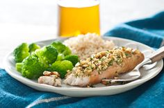 Roasted Garlic and Nut-Crusted Fish recipe - except for the cilantro blech Oven Roasted Tilapia Recipe, Parmesan Crusted Tilapia, Tilapia Recipes, Roasted Garlic, Fish Recipes, Seafood Recipes, Ww Recipes, Dinner Recipes, Kraft Foods