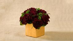 Deep Red Roses With Greens In A Gold Vase