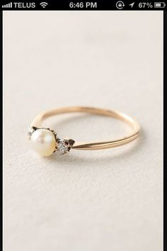 a starter ring, haha. perfectly simple pearl and diamond decoration. needs to be silver