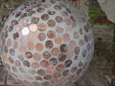 bowling ball, pennies, grout
