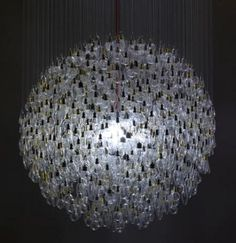 Made of 1243 spent incandescent light bulbs, the What Watt? chandelier marks the phasing-out of incandescent bulbs since its invention 130 years ago, in favor of low-energy alternatives.    The London designer Tim Fishlock made the bulbs suspended in a spherical formation with a 1.1 meter diameter, surrounding a single compact fluorescent bulb.
