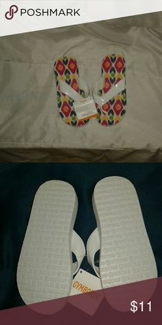 sandals These are NWT nice thick sandals they have a colorful pattern on the top we're u place your feet the bottoms ate white perfect for a day at the beach. Made for girl's Shoes Sandals & Flip Flops