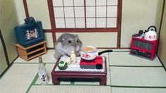 """""""Kawanabesatou"""" he photographs his pet hamsters as they tend the tiny bars he's built for them."""