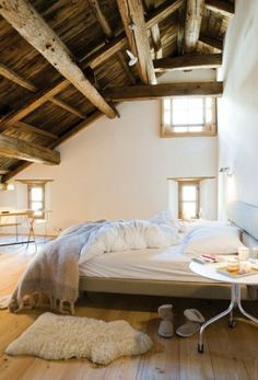 raw wood trim white walls and linens