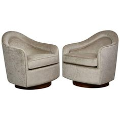 Milo Baughman Pair of Swivel Lounge Chairs | From a unique collection of antique and modern swivel-chairs at https://www.1stdibs.com/furniture/seating/swivel-chairs/