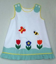 Kayla by Bonnie Blue Patterns w/Ellen McCarn applique on white pique trimmed in tiny gingham with medium yellow rick rack