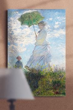 """""""Woman with a Parasol - Madame Monet and Her Son"""", also known as """"The Stroll"""" is an oil-on-canvas painting by Claude Monet. The painting depicts the artist's wife, Camilla, with their son Jean on one of the windy summer days of the 1871–77 period, when the Monet family lived in Argenteuil.   The canvas art print with the impressionist masterpiece will be a great addition to your living room or bedroom. Canvas Art Prints, Claude Monet, Oil On Canvas, Canvas, Painting, Art, Canvas Art, Abstract, Canvas Painting"""