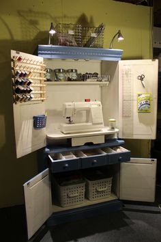 The finished cabinet.... I added a couple of wire baskets on top for patterns and idea books.  The lights came from IKEA.  It's pretty dark in the basement, so I knew I would need extra lighting.  The spool holder came from JoAnns.  I used 3M Command hooks to hang the other items.   I love the idea of sitting down to sew and having everything right within my reach.  I can work on projects now while the kids are playing ping-pong, board games or playing the Wii.