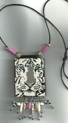 found this lovely tiger pattern on Pinterest...my version...peyote beaded necklace