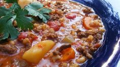 This thick and hearty hamburger soup is loaded with vegetables and barley.