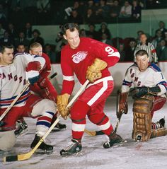 Helmet, shmelmet...Gordie Howe, doing what he does best: playing some good hockey.