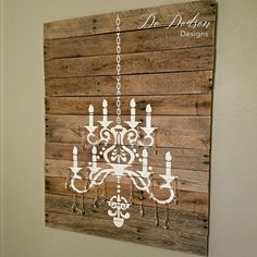 See how I created this unique one of a kind repurposed pallet wood, stenciled chandelier wall decor for just a few dollars. With real crystals!