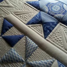 Green Fairy Quilts. Kimberly Einmo's beautiful blue and white quilt made from one jelly roll and one layer cake with amazing quilting by Judi Madsen