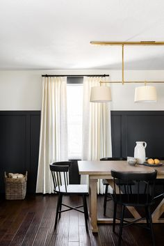 4 Lighting Ideas From Dream Home Makeover - Studio McGee Wooden Dining Tables, Dining Table Chairs, Dining Rooms, Makeover Studio, Studio Mcgee, Custom Window Treatments, Custom Windows, Slipcovers For Chairs, Living Spaces