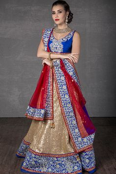 Sequined ghagra with rawsilk blouse and net dupatta embellished with zari and stone work