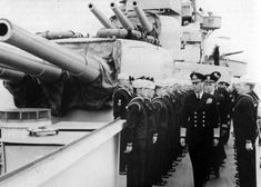 King George VI. in admiral's uniform, makes an inspection tour of the heavy cruiser USS Augusta (CA-31) at Portland, England, just after 1400 on May 25, 1944.