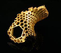 Honeycomb Ring   Material: Silver 925, 22k gold plating  Technique: CAD, RP, Casting, sandblasting, gold plating.  Designer: Karolina Bik