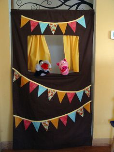 Doorway puppet theater - held in place with a tension rod, easily rolled up for storage!  Kids LOVE it!
