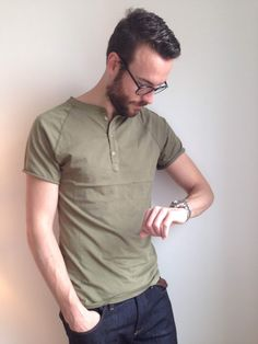 What started as a functional shirt for British rowers is now a style staple. Short-sleeve olive henley by Pistol Lake. Dark denim by Mott & Bow. Glasses by Warby Parker. Stainless steel dive watch by Invicta.