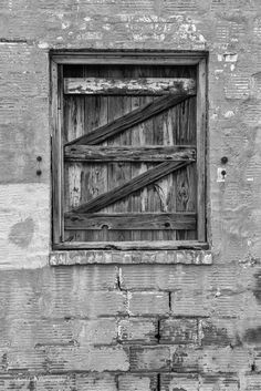 https://flic.kr/p/txxrN9 | Once was a Window_BW | Found this window in downtown Oklahoma City.