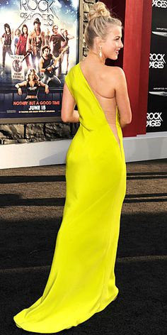 Julianne Hough does the rockstar thing at the Hollywood premiere of her film Rock of Ages, topping a striking chartreuse one-shoulder KaufmanFranco gown with Stephen Webster earrings, a messy topknot and bright tangerine lips.