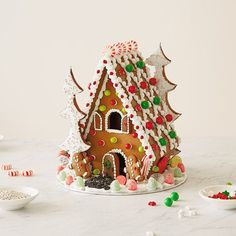 Learn how to make a gingerbread house with our step-by-step photos and instructions. Includes gingerbread house recipe, patterns and fun decorating ideas.