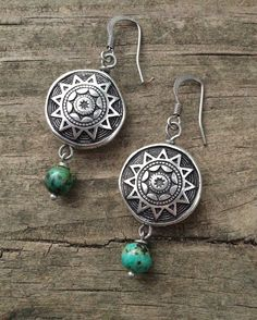 Turquoise and silver earrings. These earrings have a great southwestern, earthy feel... The focal bead is silver plated acrylic so it is very light weight, finished with beautiful African turquoise. A