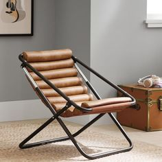 Pull up a chair—the chicest chair in the dorm, that is. With a cool sling style and comfy channeled vegan leather, this is the type of chair that makes a statement. When you need a little extra room in your space, it folds up for easy storage under your bed or in a closet.  Pottery Barn Teen Vegan Leather Caramel Channeled Sling Chair