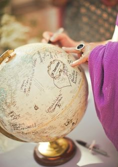 use a globe for your wedding guest book. displayed in your home later as decor.