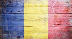 #Flag of Romania Flag of Romania painted on grungy wood plank background