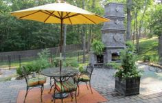 Pavers and small walls are great to define a gathering area in the back yard.  Get creative and design your own outdoor fireplace to provide an all-season focal point.