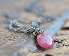 ballerina necklace . Umba pink sapphire . oxidized sterling silver. $35.00, via Etsy.