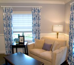 The blue pattern drapery really pops in this neutral living room.