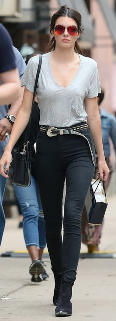 The model dresses down in a simple grey t-shirt and high-waisted skinny jeans while out in NYC.