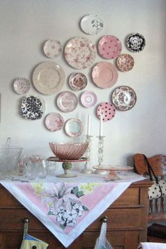 Pink plates on the wall. This post has a lot of different wall display ideas! Plate displays are an inexpensive way to add art to your room while showing ... & 21 brilliant ways to display collections | Box Collection and Display