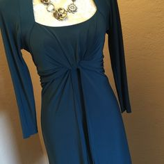 Gorgeous Dress The color of this elegant dress is Teal/Turquoise. It is fully lined and rouched at the waist for a very flattering fit. Gently worn to one formal event. Perfect condition. Looks great with silver colored pumps. Jones New York Dresses Midi