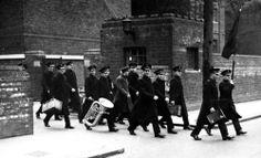 Salvation Army cadets leaving Booth Memorial Training College for a revival meeting in a nearby slum area. London, 1940.