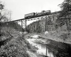 "Circa 1900. ""Detroit Photographic car crossing DL&W bridge over the Passaic at Millington, New Jersey."""